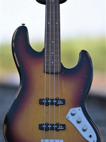 Vintage VJ74 MRJP JP Tribute Fretless Bass – Distressed Sunburst